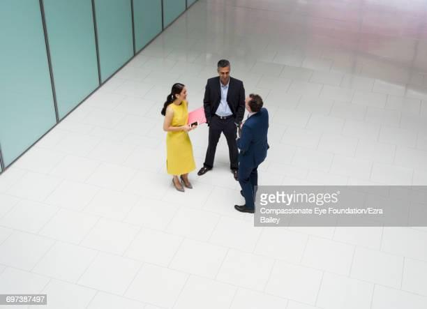 Business people talking in modern lobby