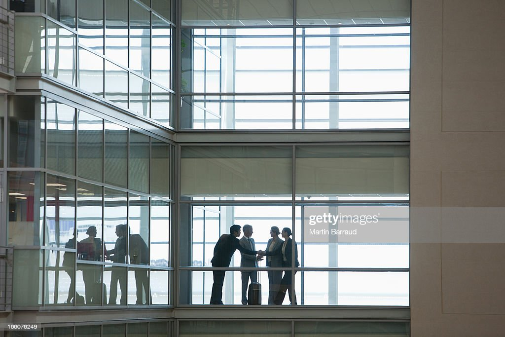 Business people talking in modern office corridor : Stock Photo