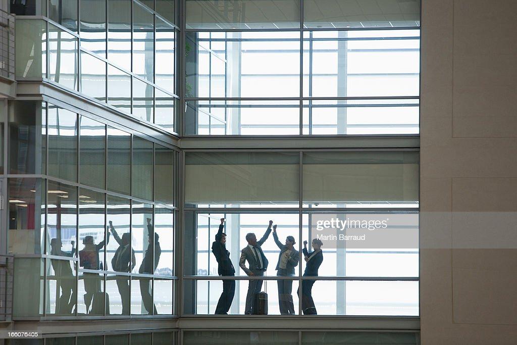 Business people talking in modern office corridor : Stock Photo
