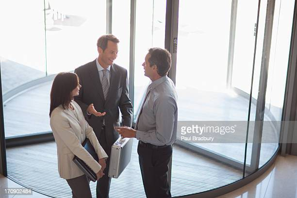 Business people talking in office lobby
