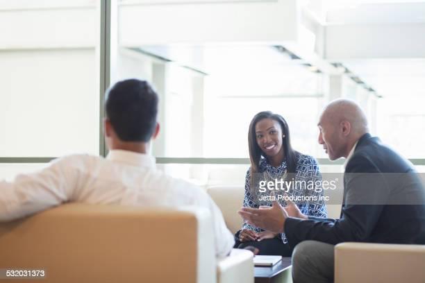Business people talking in office lobby