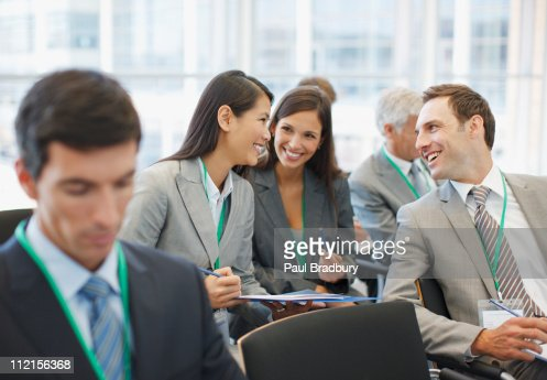 Business people talking in seminar in office