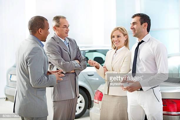 Business people talking in showroom.