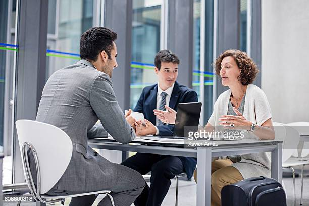 Business people talking in the airport cafeteria