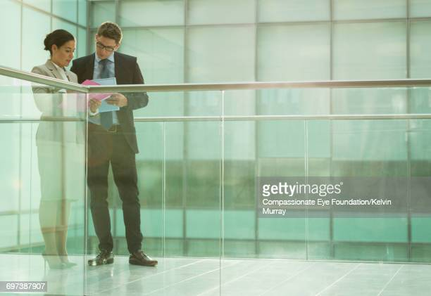 Business people talking on balcony