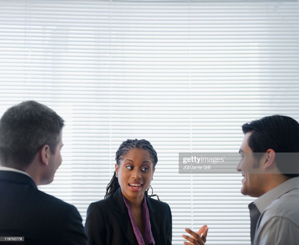Business people talking together in office : Stock Photo