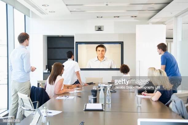 Business people teleconferencing in office meeting