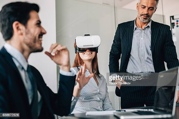 Business people testing VR simulator