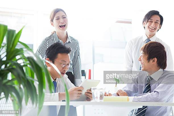 Business people to have a meeting while looking at  tablet