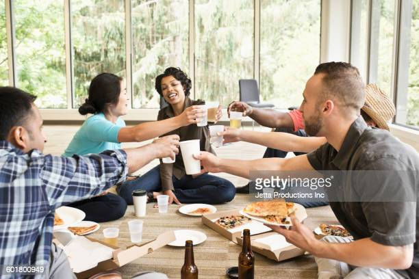 Business people toasting in office meeting
