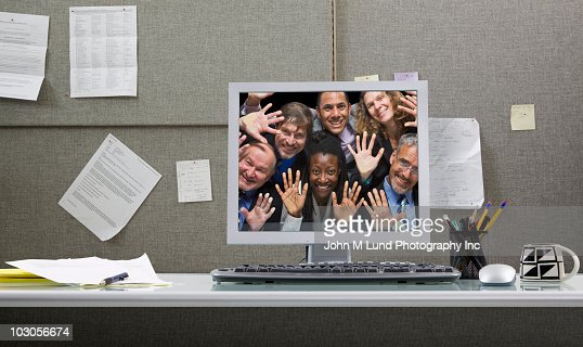 Business people trapped in computer monitor : Stock Photo