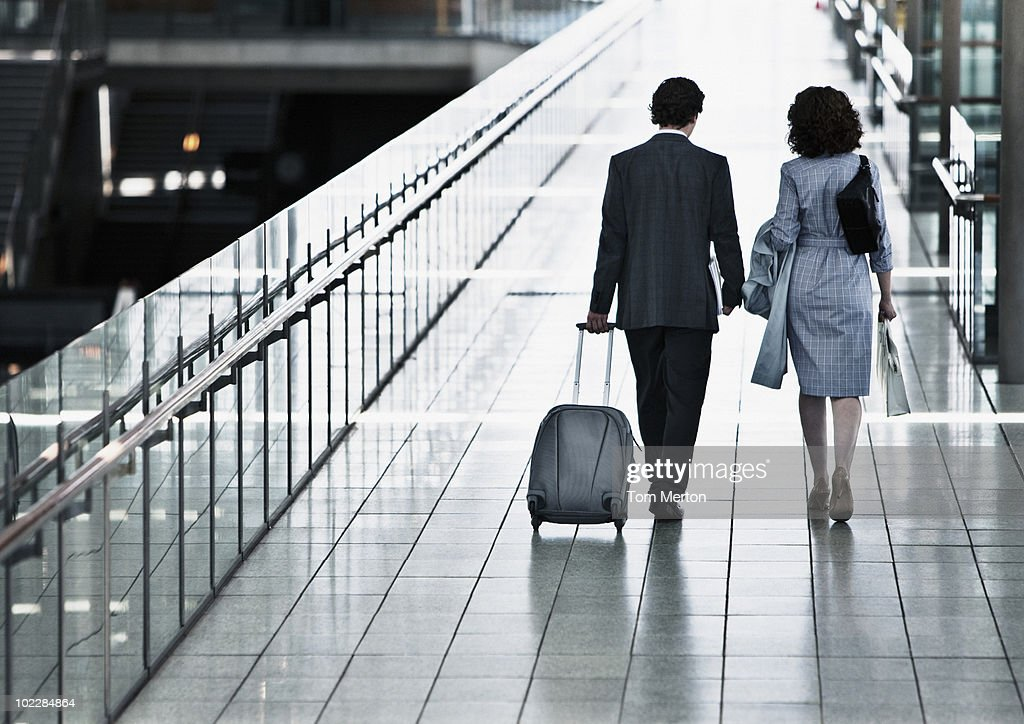 Business people traveling together : Stock Photo