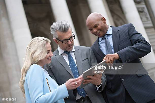 Business people using a tablet outdoors
