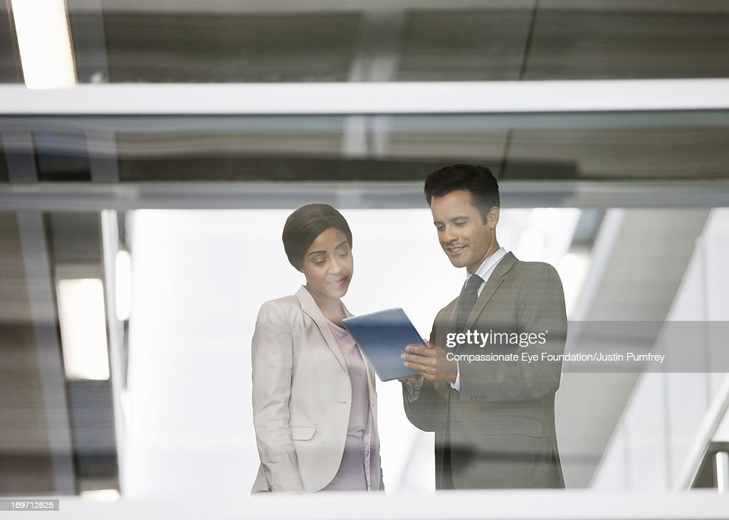 Business people using digital tablet in office : Stock Photo