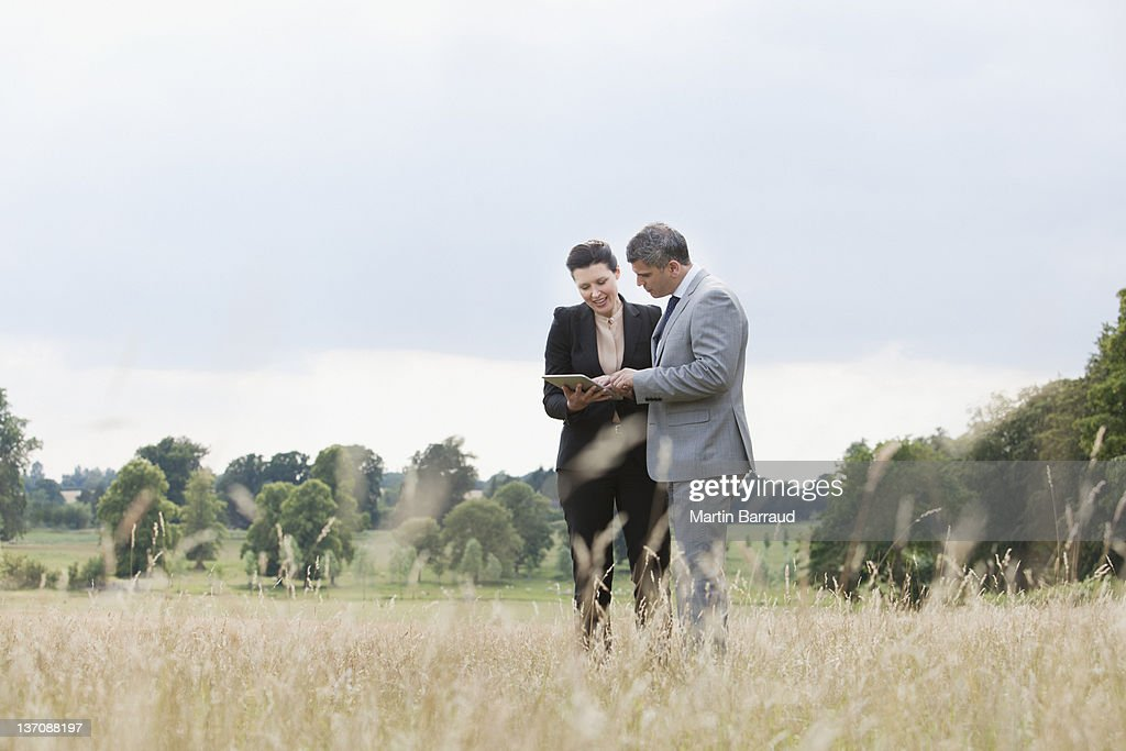 Business people using digital tablet outdoors : Stock Photo