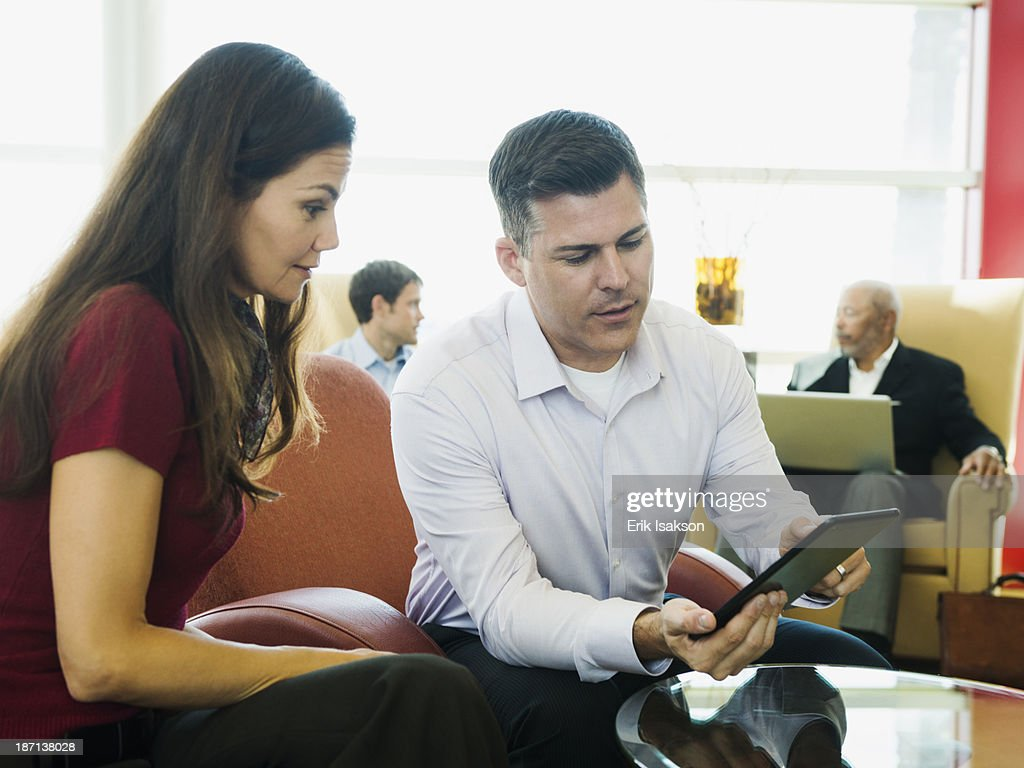 Business people using digital tablet : Stock Photo