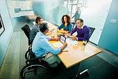 Business people using digital tablets in office meeting