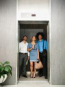Business people using elevator
