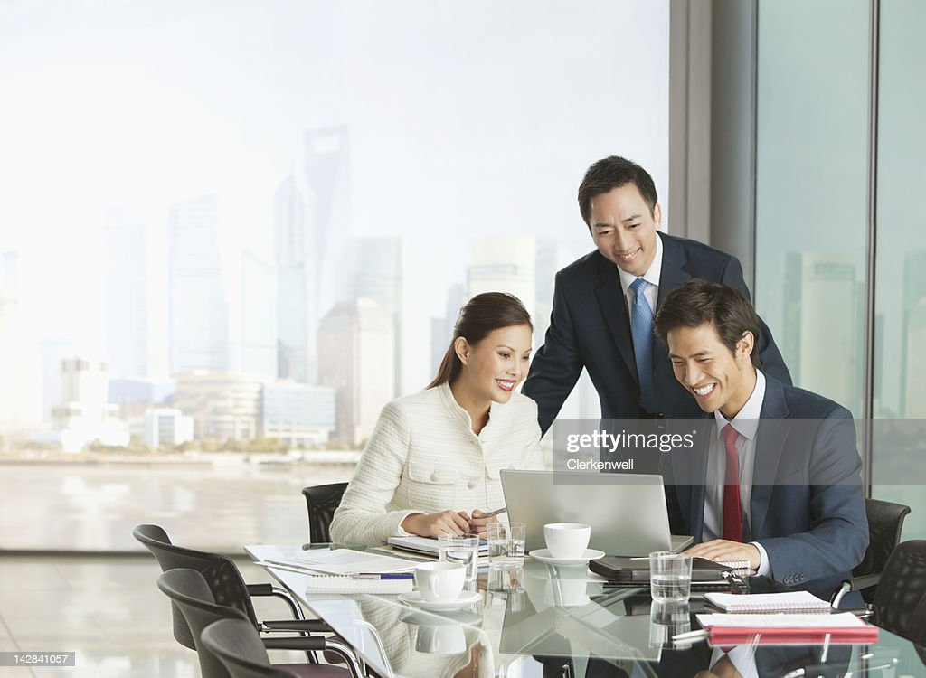 Business people using laptop in meeting : Stock Photo