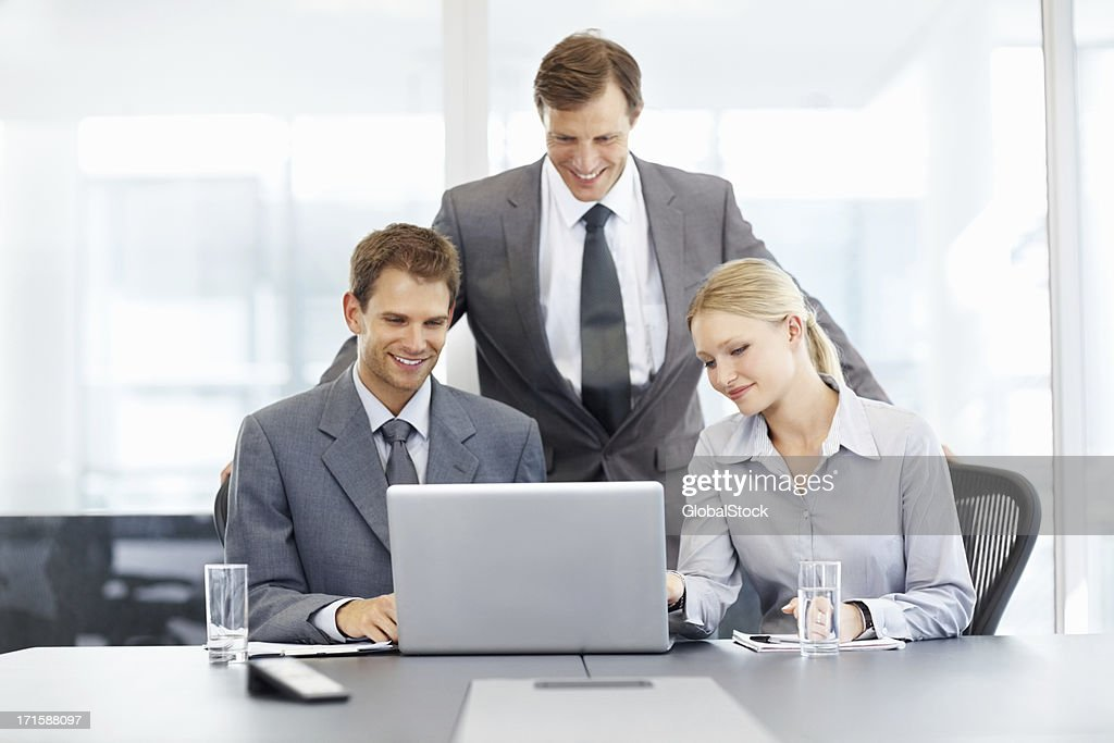 Business people using laptop in the conference room : Stock Photo