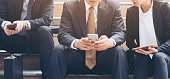 Business people using phone and tablet computer. Communication technology and business concept.