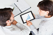 Business people using tablet computer