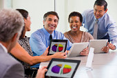 Business people using tablet computers in meeting