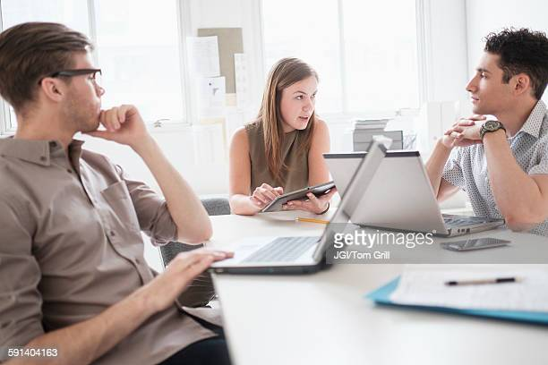 Business people using technology in office meeting
