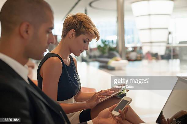 Business people using technology