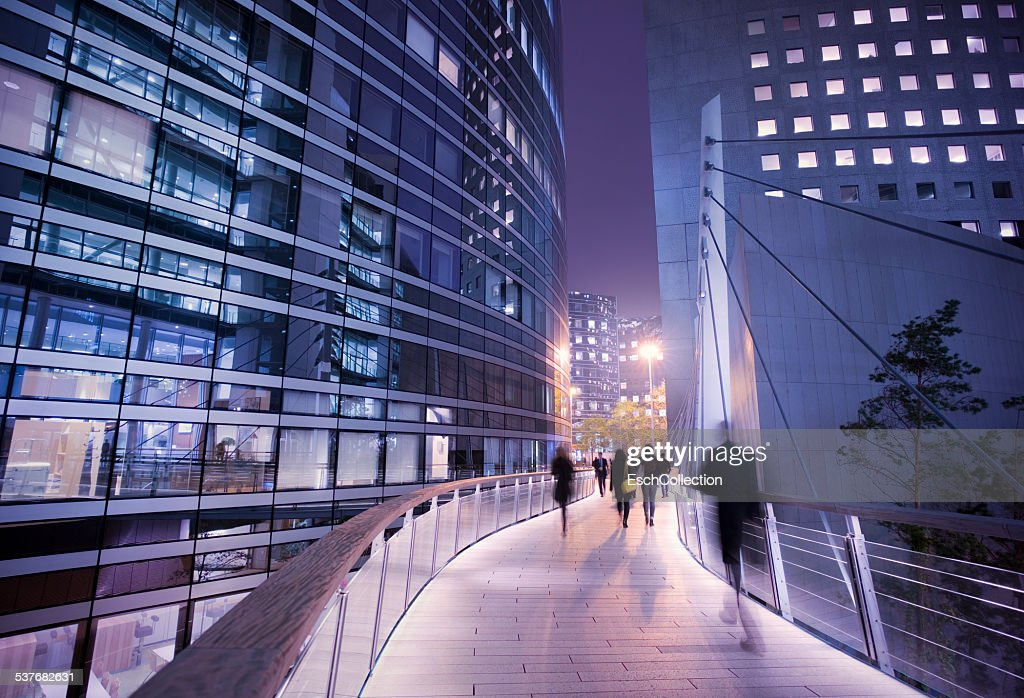 Business people using walkway at business district : Stock Photo