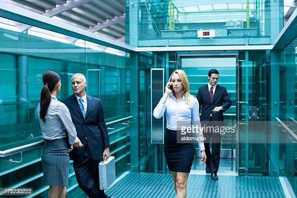 Business people waiting for the elevator