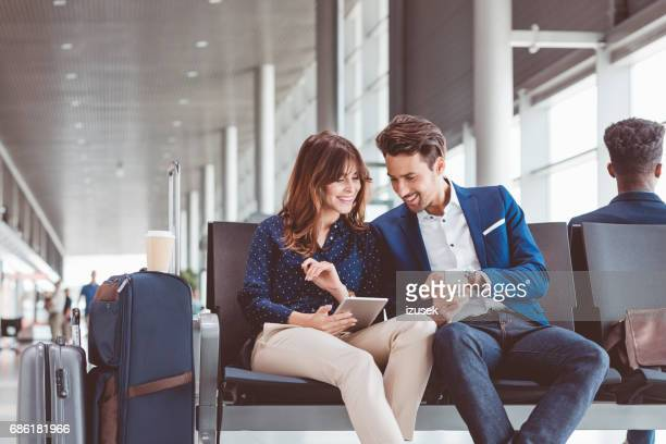 Business people waiting in airport for their flight