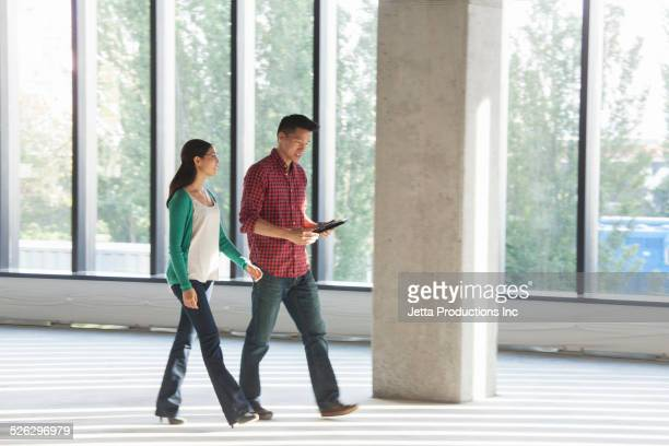 Business people walking and talking