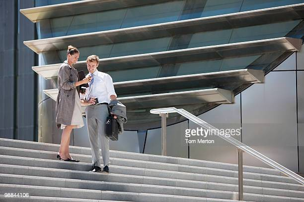 Business people walking down steps outdoors