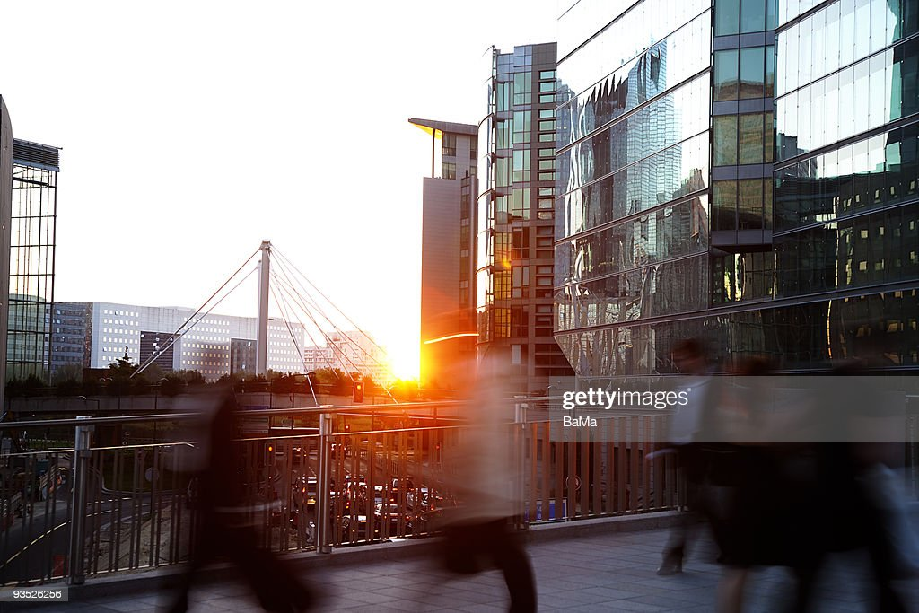 Business people walking home at sunset : Stock Photo