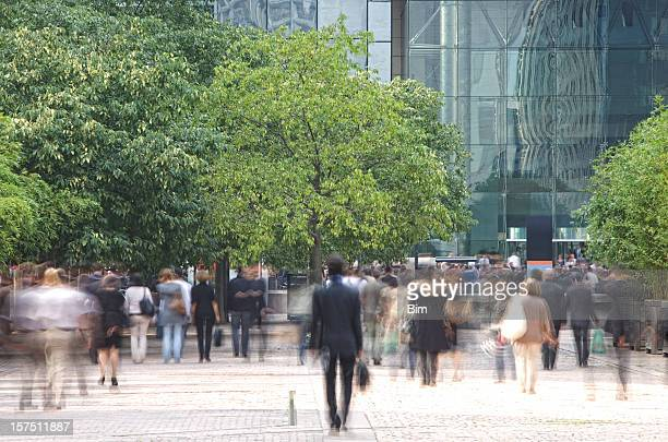 Business people walking in a financial district, blurred motion