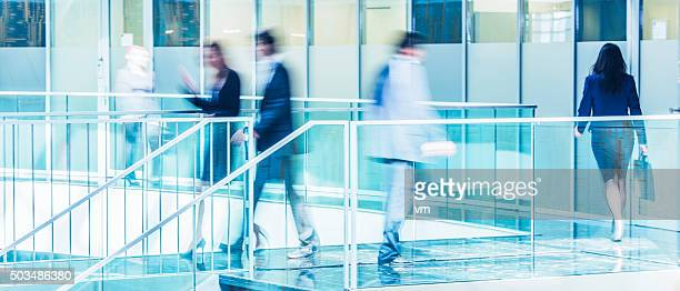 Business people walking in a modern office lobby