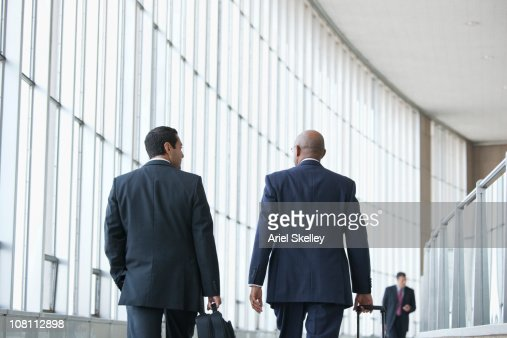 Business people walking in airport : Stock Photo