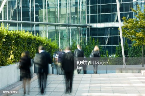 Business People Walking in Financial District, Blurred Motion