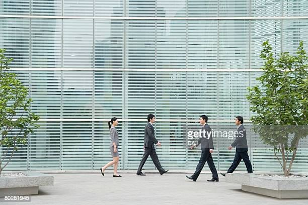 Business People Walking in front of Building, China, Beijing