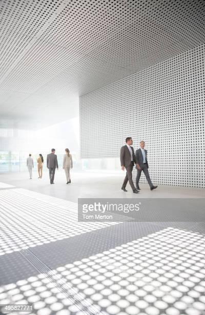 Business people walking in modern courtyard