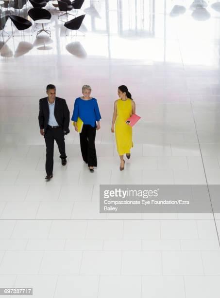 Business people walking in modern lobby