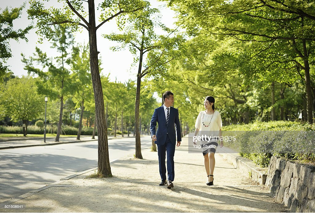 Business people walking in the park