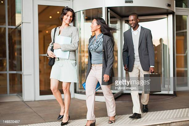 Business people walking on steps