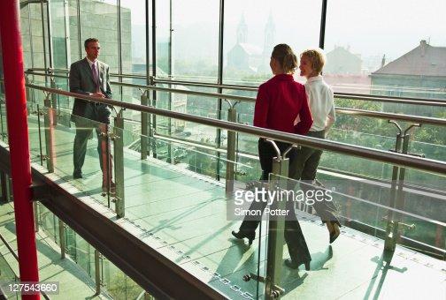 Business people walking on walkway