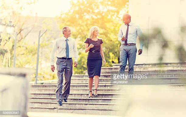 Business people walking outdoors.