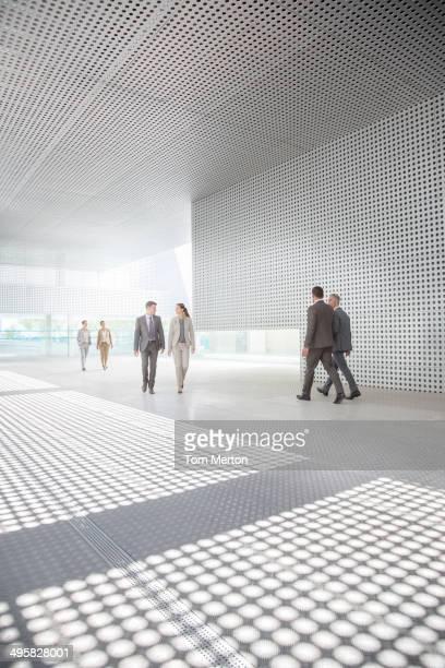 Business people walking outside modern building