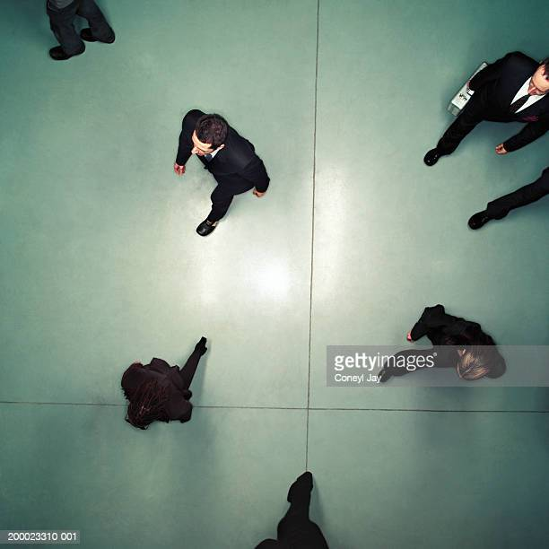 Business people walking, overhead view