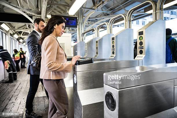 Business people walking through subway gates