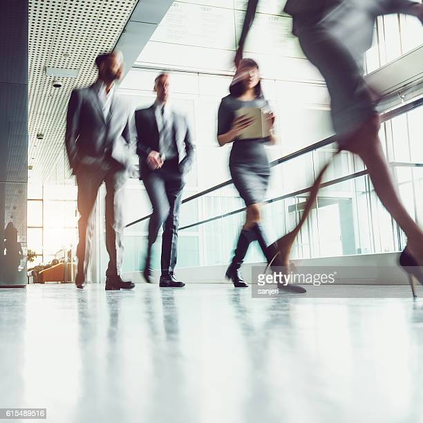 Business People Walking Through the Corridor